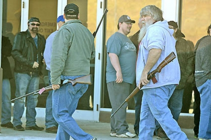 Patrons leave the Pennsylvania Gun Collectors Association gun show at the Expo Mart at Pittsburgh Mills near Tarentum with their rifles Saturday.