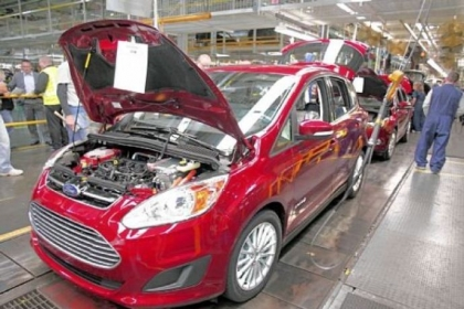 Ford workers assemble a C-MAX hybrid at the Michigan Assembly Plant in Wayne. The plant is the only one in the world that builds vehicles with five different fuel efficient powertrains on the same line.