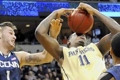 Pitt's Dante Taylor pulls down a rebound against Connecticut's Enosch Wolf in the second half.