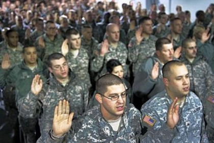 "National Guard soldiers and airmen from more than 25 states take an oath at the National Guard Armory in Washington, D.C., on Friday to make them deputized ""special police officers"" for the 57th presidential inauguration to take place Monday."