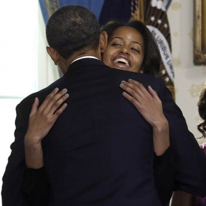 President Barack Obama hugs daughter Malia after taking the oath of office.