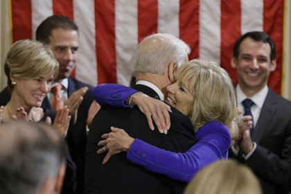 Vice President Joe Biden hugs his wife Jill Biden after taking the oath of office during and official ceremony at the Naval Observatory.