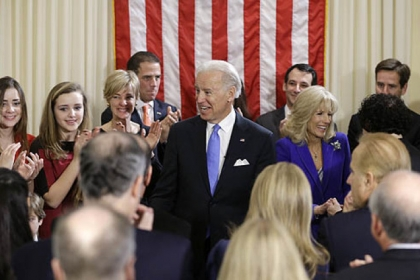 Vice President Joe Biden, with his wife Jill Biden, celebrate after taking the oath of office from Supreme Court Justice Sonia Sotomayor surrounded by family during an official ceremony at the Naval Observatory.
