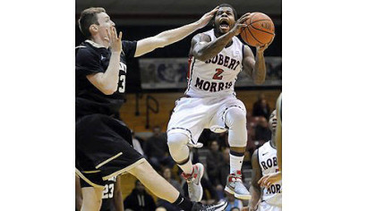 Robert Morris' Velton Jones drives to the net against Bryant's Joe O'Shea in the first half Thursday night.