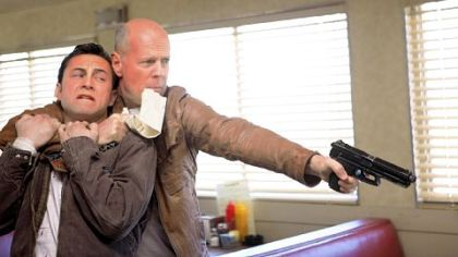 "Joseph Gordon-Levitt, left, and Bruce Willis play the same character, Joe, in ""Looper."""