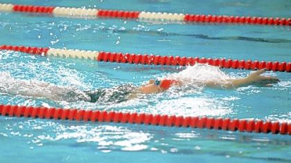 Moon Area High School senior Alexis Mitcheltree swims backstroke last Thursday.