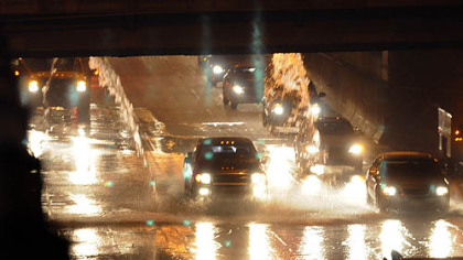 "Water from a break on Fort Pitt Boulevard cascades into the ""bathtub"" section of the westbound Parkway East early Thursday morning."