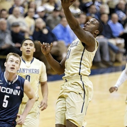 Pitt's Lamar Patterson shoots in front of Connecticut's Niels Giffey in the first half of the Panthers' 69-61 win Saturday.