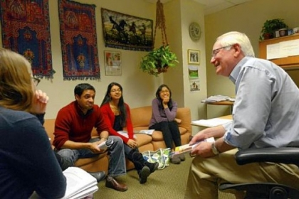 Dr. Bruce Rabin speaks about how different colors affect moods with, from left, Samantha Leathers, Vishal and Divya Parikh, and Mamie Thant, all fourth-year Pitt medical students, while holding a class on the science of stress inside his office at UPMC Presbyterian in Oakland.