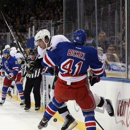Sidney Crosby, rear, knocks the Rangers' Stu Bickel off the puck in the Penguins' 6-3 victory Sunday night at Madison Square Garden in New York.