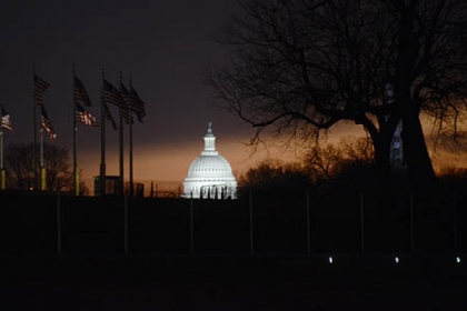 Dawn breaks in Washington, D.C., and illuminates the Capitol dome on inauguration day for Barack Obama's second term.