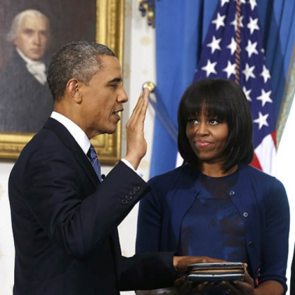 President Barack Obama is officially sworn in by Chief Justice John Roberts in the Blue Room of the White House.