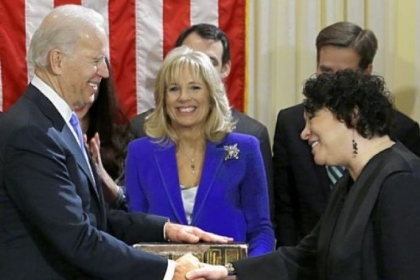 Vice President Joe Biden, with his wife, Jill Biden, center, holding the Biden family Bible, shakes hands Sunday with Supreme Court Justice Sonia Sotomayor after taking the oath of office during a ceremony at the Naval Observatory in Washington.