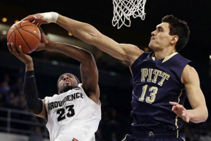 Pitt center Steven Adams blocks a shot by Providence forward LaDontae Henton during the first half.