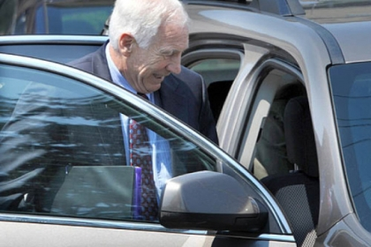 Jerry Sandusky leaves the Centre County Courthouse on Wednesday after the defense rested on the seventh day of testimony.