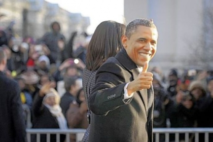 "President Obama gives the crowd along Pennsylvania Avenue a ""thumbs up"" during the inaugural parade Monday in Washington."