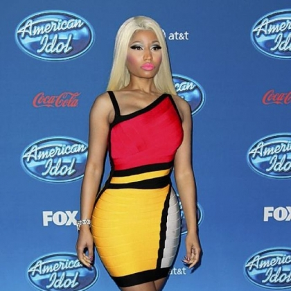 Nicki Minaj will create a line of her color-burst clothes for Kmart and ShopYourWay.com.