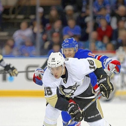 Brandon Sutter carries the puck against the Rangers Sunday in New York.