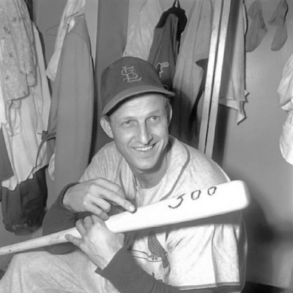 Stan Musial of the St. Louis Cardinals holds bat with which he hit his 300th major league home run in 1955.