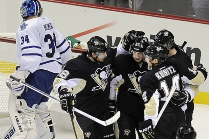 Penguins teammates congratulate Evgeni Malkin on his goal against Toronto in the first period Wednesday night at Consol Energy Center.