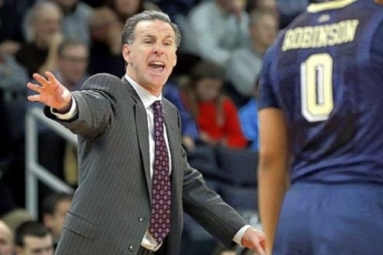 Jamie Dixon shouts instructions to James Robinson. &quot;Our offense carried us the whole game,&quot; Dixon said.