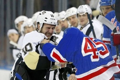 Tanner Glass gives -- and takes -- in his scrum with Arron Asham Sunday night in New York.