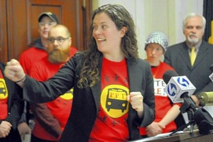 Molly Nichols of Pittsburghers for Public Transit and its community partners spoke outside Pittsburgh Council Chambers to announce a statewide campaign to save and expand public transit in Pennsylvania.