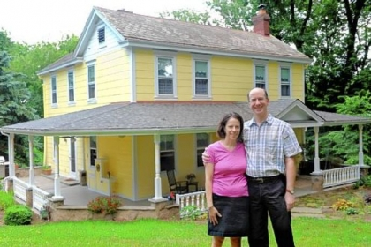 Daniel May and Jennifer Saitz pose for a portrait in front of their home in McCandless.
