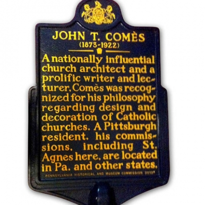 "The historical marker for ""nationally influential church architect"" John T. Comès."
