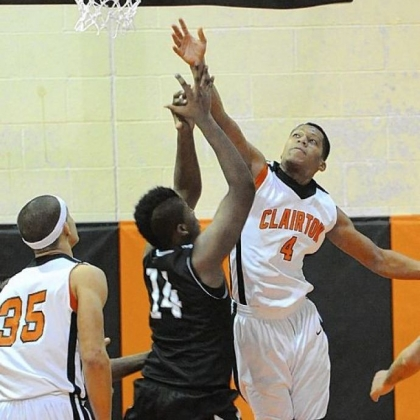 Clairton's Jojuan Bray blocks a shot by Monessen's Nickodemes Payne during a Bears victory last Friday.