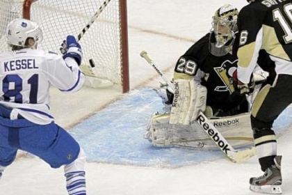 Penguins goaltender Marc-Andre Fleury watches a shot by Toronto''s Tyler Bozak go by for a goal in the third period Wednesday night at Consol Energy Center.