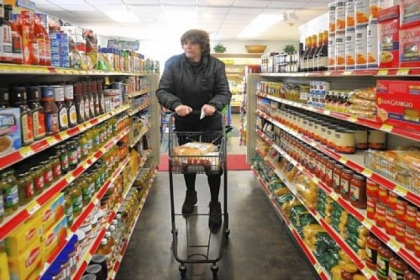 Debbie Bozek of Hunker shops at the Youngwood Corner Market. The market is close to her home, saving her from traveling to Greensburg or elsewhere to grocery shop. She walks with the aid of a cane and likes the help she receives from the store's staff.