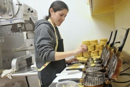 Tania Ciano makes pizzelles in the kitchen at Leonard Labriola's Italian Store in Monroeville.