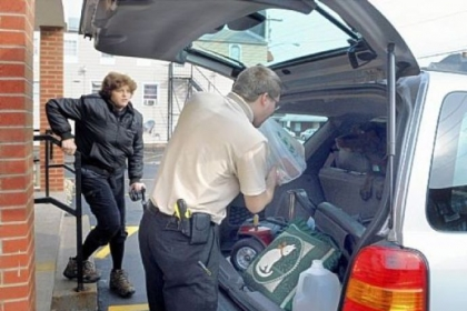 Travis Keller puts groceries in customer Debbie Bozek's car after her shopping visit to the Youngwood Corner Market. The market is close to her Hunker home.