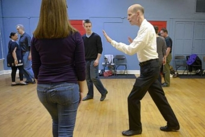 Instructor Jerry Minshall demonstrates dance moves to Holly Forsberg and Conor Shaffer, both of Squirrel Hill.
