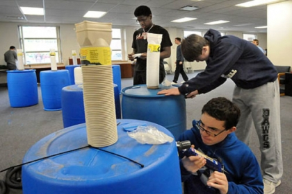 Volunteer students from the Shady Side Academy help make rain barrels at the Kingsley Center in Pittsburgh's Larimer neighborhood as part of the school's Day of Service to celebrate Martin Luther King Day.