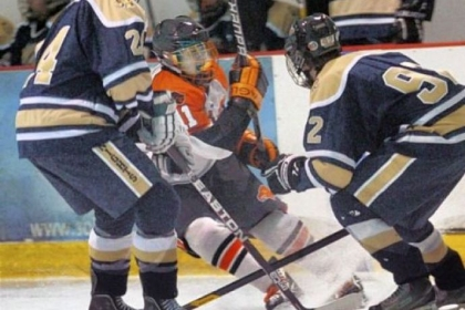 Bethel Park&#039;s Derek Lesnak battles in front of the net with Norwin&#039;s Dan Merz, left, and Christian Slafka during a game earlier this season. Lesnak, a junior captain, leads a Black Hawks team that is the least-penalized unit in PIHL Class AAA at 64 penalty minutes.