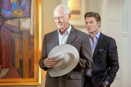 "Larry Hagman, left, as J.R. will appear in the first few episodes of the second season of ""Dallas."" The actor died in November, and his character's death was written into the TNT reboot. Josh Henderson portrays his son, John Ross."