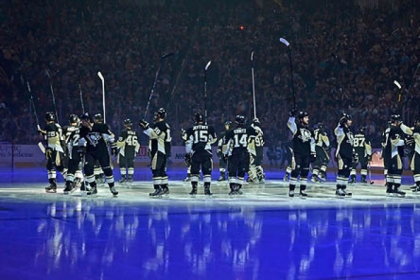 Penguins wave to the crowd at opening night ceremonies at Consol Energy Center on Wednesday night.