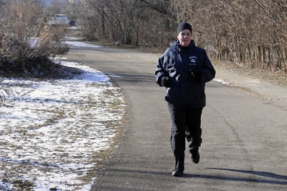 "Joanne Mule of Bellevue runs Thursday on the Three Rivers Heritage Trail in South Side Riverfront Park. ""It's never too cold to run,"" she said."