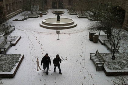 Snow starts to stick Friday morning in the courtyard of the Allegheny County Courthouse in Downtown Pittsburgh.