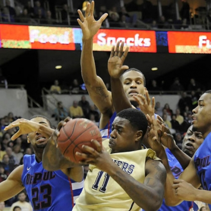 Pitt's Dante Taylor pulls down a rebound against DePaul in the first half at the Petersen Events Center.