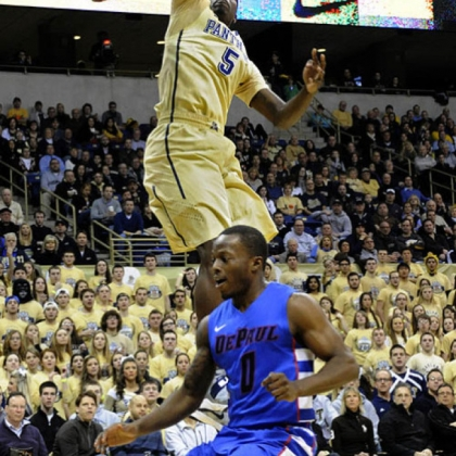Pitt's Durand Johnson dunks in front of DePaul's Worrel Clahar in the first half.