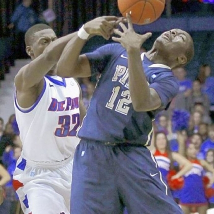 DePaul guard Charles McKinney battles Pitt guard Ashton Gibbs for a loose ball in January 2012 in Rosemont, Ill. DePaul upset the Panthers, 84-81, after Pitt blew a 10-point second-half lead.