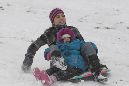 Sana Samson of Mt. Lebanon sleds in Mt. Lebanon Park with her daughter Shiloh, 4.