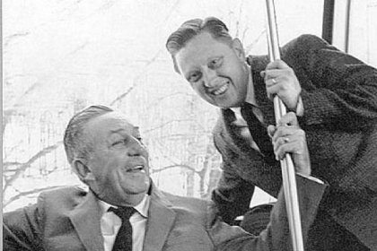 Former Westinghouse photographer Jack Merhaut, right, with Walt Disney in the late 1960s. Mr. Merhaut died Jan. 20.