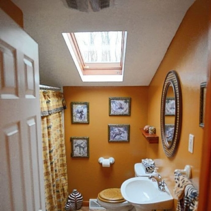 The upstairs bathroom features a skylight.