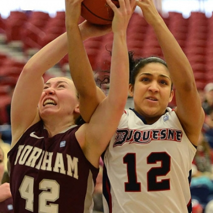 Duquesne's Jocelyn Floyd fights for the rebound against Fordham's Abigail Corning.