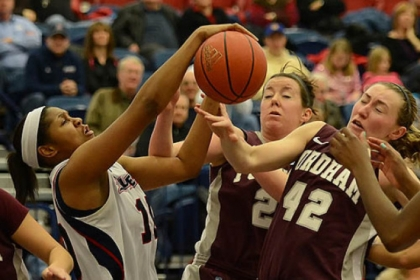 Duquesne's Wumi Agunbiade fights for a rebound against Fordham's Abigail Corning.