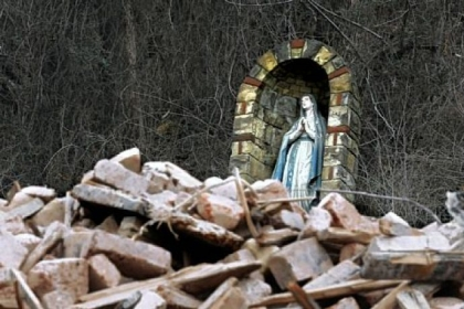 The Virgin Mary overlooks the rubble of what used to be St. Nicholas Church on Route 28.